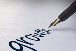 Fountain pen writing the word growth